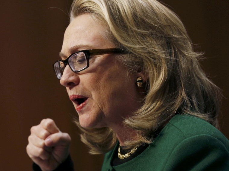 Secretary of State Hillary Clinton pounds on her fist on her table while testifying on the September attack on U.S. diplomatic sites in Benghazi, Libya during a hearing held by  the U.S. Senate Foreign Relations Committee on Capitol Hill in Washington...
