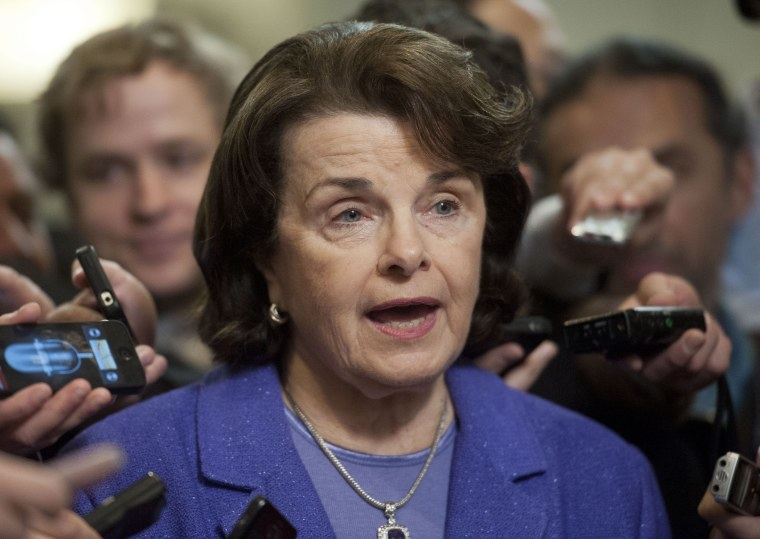 Senate Intelligence Committee Chair Sen. Dianne Feinstein, D-Calif., is surrounded by reporters on Capitol Hill in Washington, Friday, Nov. 16, 2012, following a closed-door hearing of the committee where former CIA Director David Petraeus testified. ...