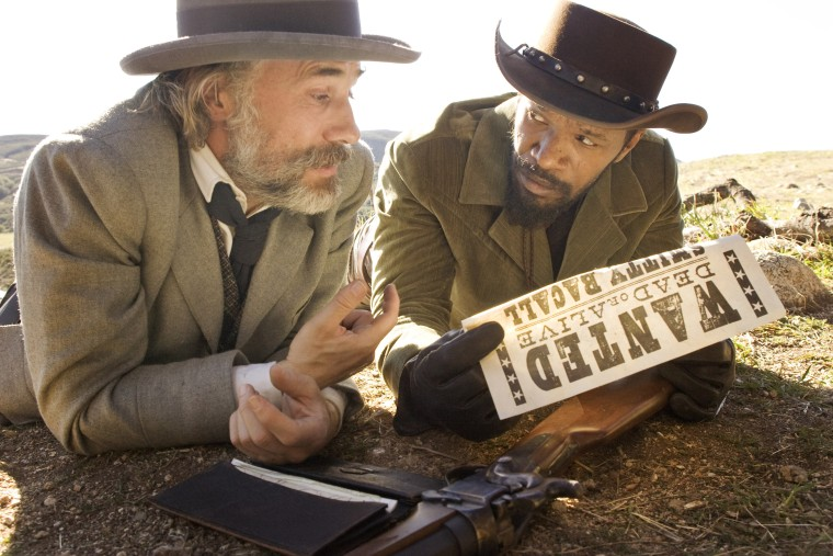 """This undated publicity image released by The Weinstein Company shows, Christoph Waltz as Schultz, left, and Jamie Foxx as Django in the film, """"Django Unchained,"""" directed by Quentin Tarantino. Foxx says Hollywood should take some responsibility for..."""