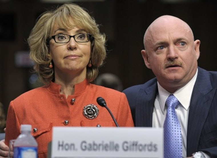 Former Arizona Rep. Gabrielle Giffords sits with her husband Mark Kelly, on Jan. 30, 2013, and gives an opening statement before the Senate Judiciary Committee hearing on gun violence. (Photo by Susan Walsh/AP Photo)