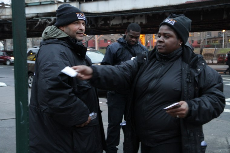 (L-R) Gilly Delgado, who is an outreach worker with S.O.S South Bronx, and Tarkesha Brown,  a violence interrupter, conduct a community outreach work on  January 30, 2013 in Bronx Borough of New York City. (Photo by Trymaine Lee/msnbc, handout)