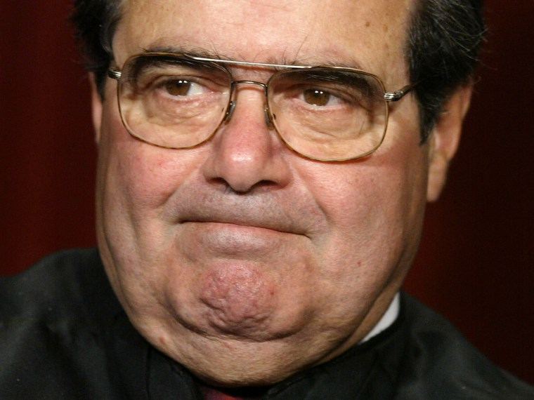 File Photo: Justice Antonin Scalia poses for photographers at the U.S. Supreme Court October 31, 2005 in Washington DC. Earlier in the day U.S. President George W. Bush nominated judge Samuel Alito to replace Sandra Day O'Connor who is retiring once...