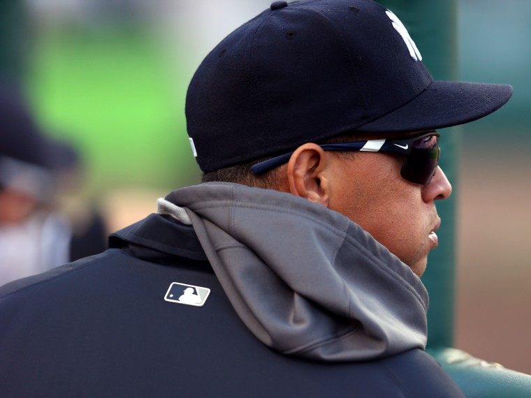 File Photo: Alex Rodriguez #13 of the New York Yankees looks on from the dugout against the Detroit Tigers during game four of the American League Championship Series at Comerica Park on October 18, 2012 in Detroit, Michigan.  (Photo by Jonathan Daniel...