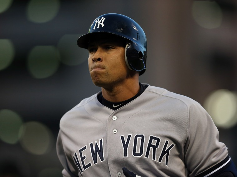 File Photo: Alex Rodriguez #13 of the New York Yankees reacts as he walks back towards the dugout after he pinch hit and flied out in the top of the sixth inning against the Detroit Tigers during game four of the American League Championship Series at...