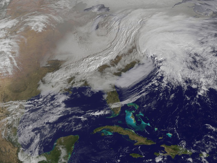 This image released by NASA from NOAA's GOES-13 satellite captured at 9:01 a.m. on Friday, Feb. 8, 2013 shows a massive winter storm coming together as two low pressure systems merge over the northeast U.S. Snow began falling across the Northeast on...