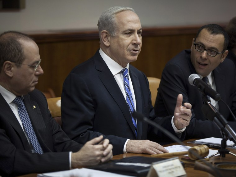 Israel's Prime Minister Benjamin Netanyahu (C) attends the weekly cabinet meeting in Jerusalem February 10, 2013. Iran's nuclear ambitions, the civil war in Syria and stalled Israeli-Palestinian peace efforts will top the agenda of U.S. President...