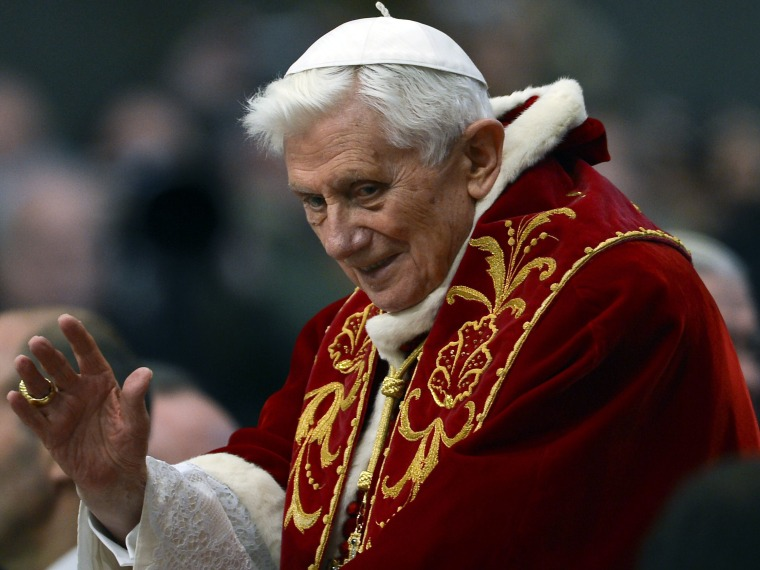 Pope Benedict XVI arrives to greet the faithful after  the mass in St.Peter's Basilica to mark the 900th anniversary of the Order of the Knights of Malta, on February 9, 2013 at the Vatican.   (Photo by Andreas Solaro/AFP/Getty Images)