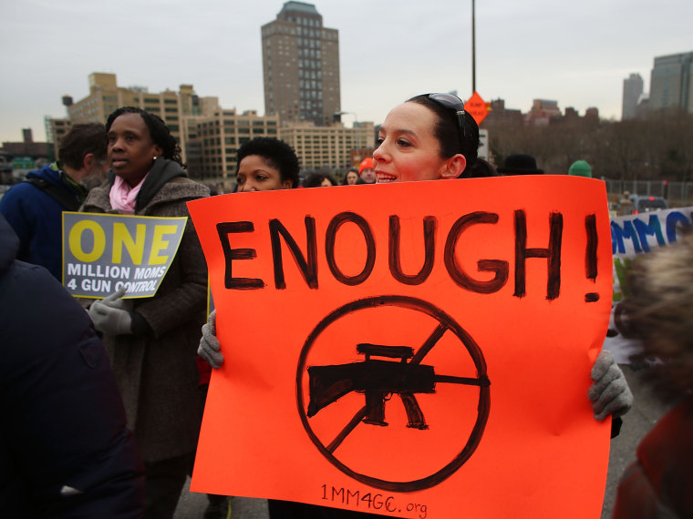 Participants with One Million Moms for Gun Control, a gun control group formed in the wake of last month's massacre at a Newtown, Connecticut elementary school, attend a rally and march across the Brooklyn Bridge on January 21, 2013 in New York City. ...