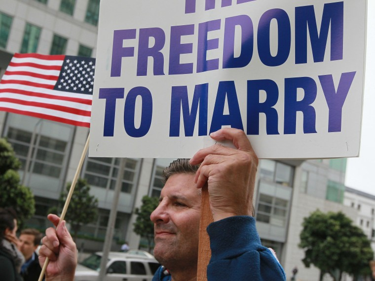 File Photo: A Prop 8 opponent  holds a sign as he awaits the verdict to overturn Prop 8 outside of the Philip Burton Federal building  August 4, 2010 in San Francisco, California.US District Judge Vaughn Walker will announce his ruling today on the...
