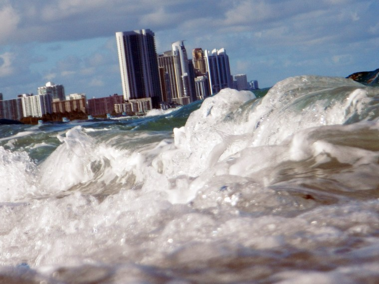 File Photo: Buildings are seen near the ocean as reports indicate that Miami-Dade County in the future could be one of the most susceptible places when it comes to rising water levels due to global warming on March 14, 2012 in North Miami, Florida....