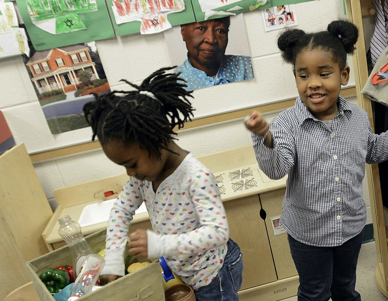 Gov. Bev Perdue, right, listens to Amaya Bryant and Jalynn Brandon, left,  Monday, Dec. 10, 2012, at Primary Colors Early Learning Center in Durham, N.C. Perdue visited the Pre-K classes to highlight the importance of preschool. (AP Photo/The Herald...