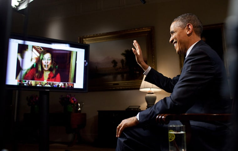 """President Obama participates in a \""""Fireside Hangout.\"""" (Official White House Photo)"""