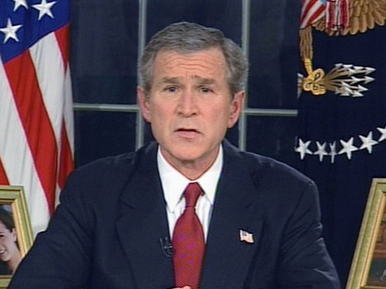 """File Photo: (VIDEO CAPTURE) In this image from video, U.S. President George W. Bush announces that the U.S. military struck at \""""targets of opportunity\"""" in Iraq March 19, 2003 in Washington, DC. Air defense sirens and anti-aircraft fire was reported..."""