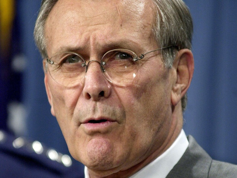 File Photo: US Secretary of Defense Donald Rumsfeld briefs the press at the Pentagon in 2001. (Photo by Shawn Thew/AFP/Getty Images, File)