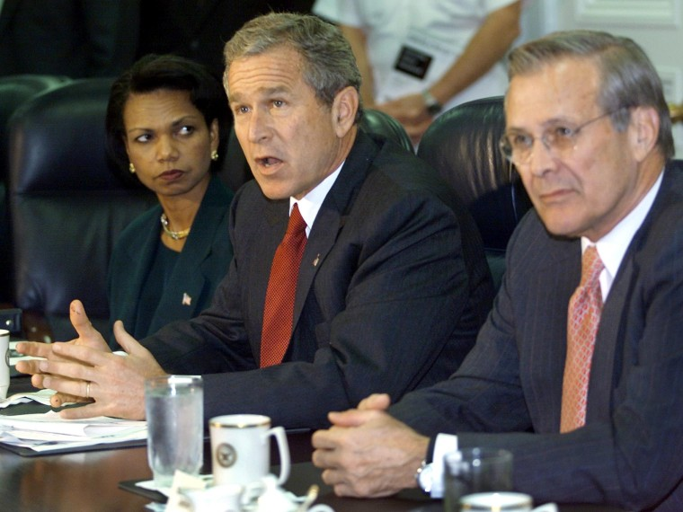File Photo: US President George W. Bush (C) answers questions from the media as US National Security Adviser Condoleezza Rice (L) and US Secretary of Defense Donald Rumsfeld (R) look on during a meeting with military leaders at the Pentagon 17...