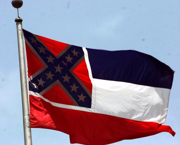 """The Mississippi flag, photographed at the Capitol in Jackson, has been compared to a """"badge of slavery,"""" by civil rights groups.  (Photo by Rogelio Solis/AP)"""