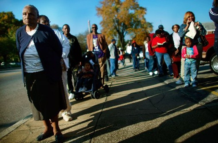 File Photo: African-Americans line up to vote in the presidential election November 4, 2008 in Birmingham, Alabama. (Photo by Mario Tama/Getty Images)