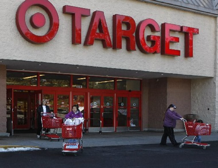 Shoppers exit a Target store with their purchases in Fairfax, Virginia, February 4, 2010. (REUTERS/Stelios Varias)
