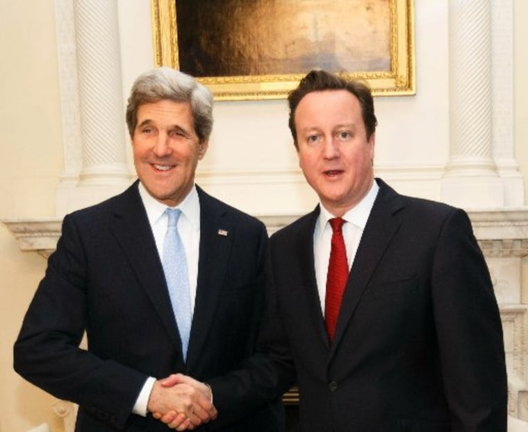 LONDON, ENGLAND - FEBRUARY 25:  British Prime  David Cameron (R) shakes hands with US Secretary of State John Kerry inside 10 Downing Street on February 25, 2013 in London, England. Mr Kerry is on an 11-day tour and is due to visit Berlin, Paris, Rome,...