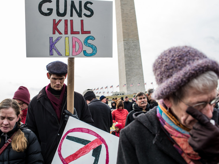 Cori Lynn Campbell, her husband Erik Singer, both of Maplewood, New Jersey, and Martha Nichols, of Vienna Virginia, participate in a rally on the National Mall for stricter gun control laws on January 26, 2013 in Washington, DC. Demonstrators included...