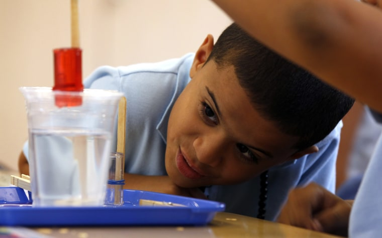 A nine-year-old student keeps an eye on his science experiment at a Lancaster, PA middle school. (AP Photo/Alex Brandon)
