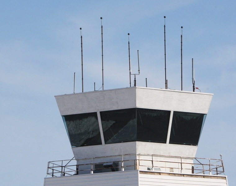 A twin engine airplane flies by the tower at St. Louis Regional Airport in Bethalto, Ill., Monday Feb. 25, 2013, before circling to land. The airport is one of 100 airports nationwide with less than 150,000 annual flights that will likely loose their...