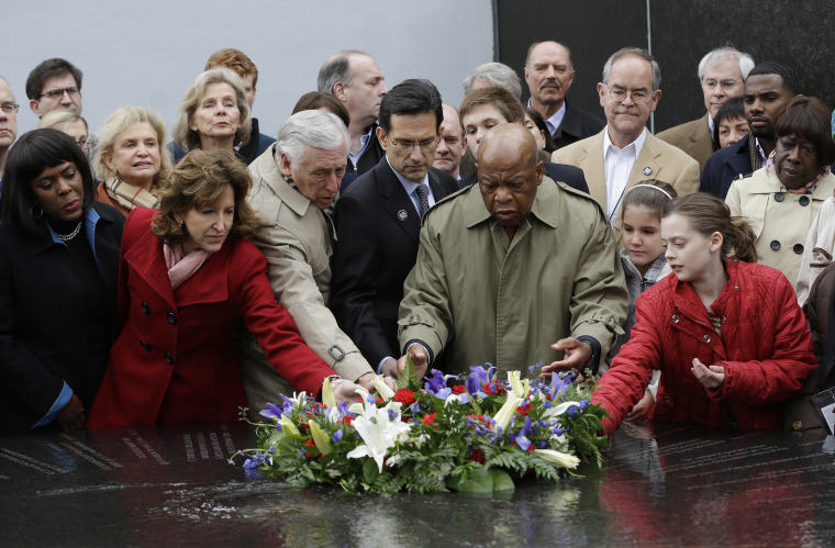 Lawmakers and other gather for a wreath laying ceremony at the Civil Rights Memorial at the Souther Poverty Law Center in Montgomery, Ala., Saturday, March 2, 2013. The Faith and Politics Institute sponsored the event. Front row from left: U.S. Rep....