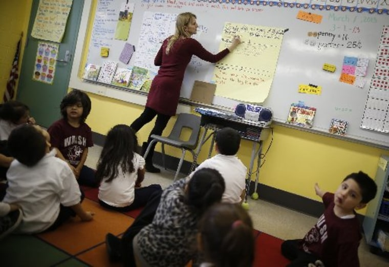 Teacher Audrey Benes speaks to her kindergarten class at Walsh Elementary School in Chicago, Illinois, March 1, 2013. According to officials in U.S. President Barack Obama's administration, possible consequences of impending across-the-board U.S....