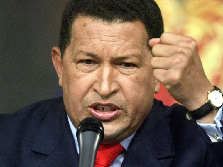 File Photo: Venezuelan President Hugo Chavez speaks at a press conference in Miraflores Palace December 5, 2006 in Caracas, Venezuela. Chavez was officially declared the re-elected president by electoral authorities today after defeating challenger...