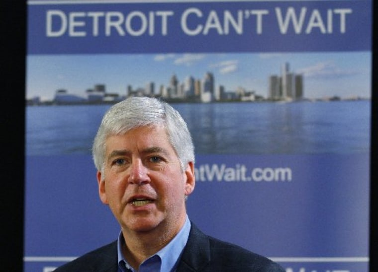 Michigan Governor Rick Snyder talks about the city of Detroit being in a financial emergency state during a  meeting with an invited audience at Wayne State University in Detroit, Michigan March 1, 2013.   (REUTERS/ Rebecca Cook)
