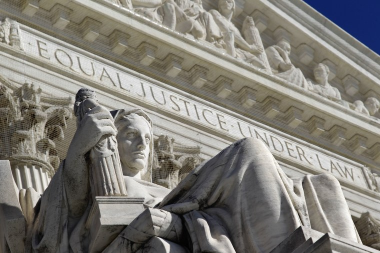 File Photo: The west facade of the U.S. Supreme Court. (Photo by: J. Scott Applewhite/AP Photo)