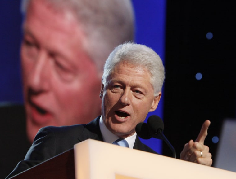 Former President Bill Clinton addresses the crowd as he takes the stage during the Democratic National Convention in Denver, Wednesday, Aug. 27, 2008. (AP Photo/Charles Dharapak)