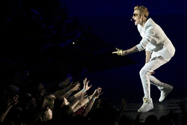 Canadian singer Justin Bieber performs live in concert at the O2 in London, on March 4, 2013. AFP PHOTO / JUSTIN TALLISJUSTIN TALLIS/AFP/Getty Images