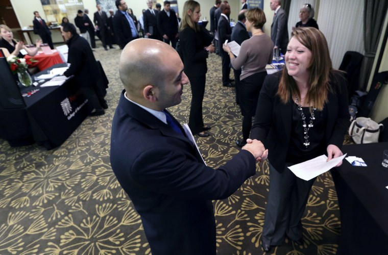 In this Monday, Feb. 25, 2013, photo, Sayed Mouawad, left, of Providence, R.I., shakes hands with Jillian Wallace of Matix, Inc., during a job fair in Boston. The number of people seeking U.S. unemployment aid fell to a seasonally adjusted 340,000 in...