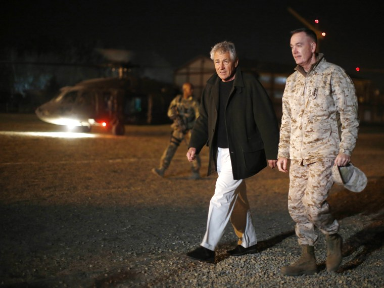 Hagel (C) steps off his helicopter with US Marine General Joseph Dunford (R), Commander of the International Security Force upon Hagel's arrival near Camp Eggers in Kabul, Afghanistan, on March 8, 2013. It is Hagel's first official trip since being...