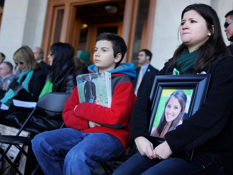 Heather Cronk and Zach Fagan hold up pictures of their cousin Victoria Soto, a first-grade teacher killed at Sandy Hook Elementary School in Newtown, at a rally at the Connecticut State Capital to promote gun control legislation in the wake of the...