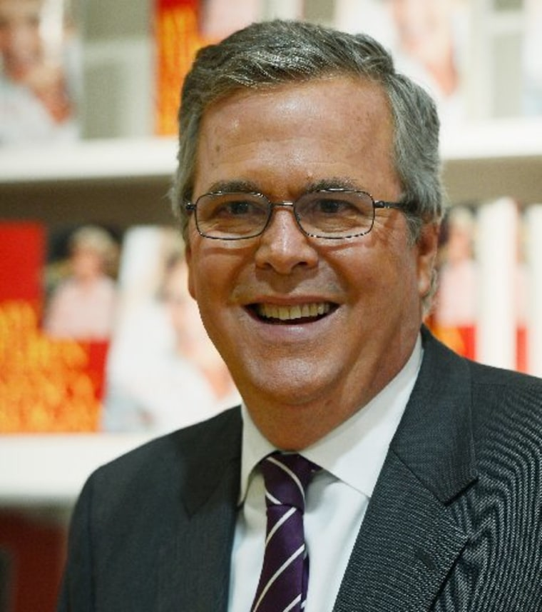 """SIMI VALLEY, CA - MARCH 08:  Former Florida governor Jeb Bush autographs his new book \""""Immigration Wars: Forging an American Solution\"""" before speaking at the Reagan Library about his new book on March 8, 2013 in Simi Valley, California.(Photo by Kevork..."""
