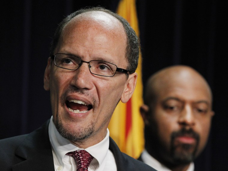 File Photo: Thursday, May 10, 2012 file photo, United States Assistant Attorney General Thomas Perez, left, who heads up the civil rights division at the Department of Justice, is joined by Deputy Assistant Attorney General for Civil Rights, Roy Austin...