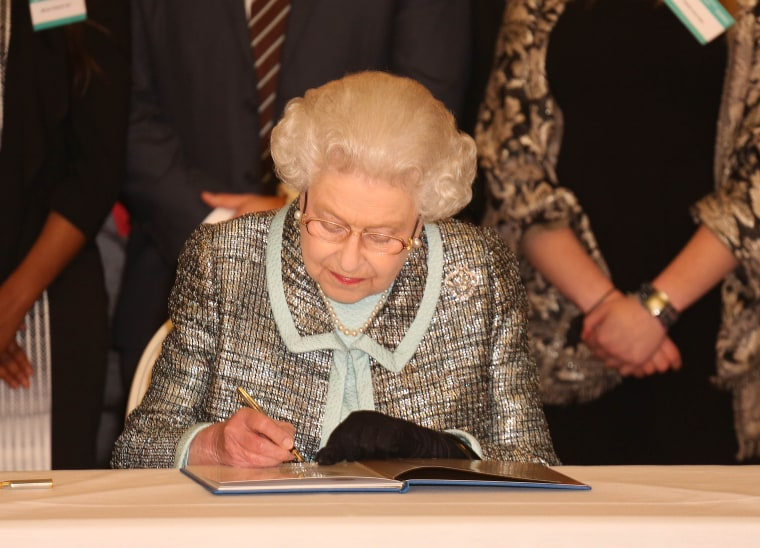Commonwealth Day. Queen Elizabeth II, Head of the Commonwealth signs the Commonwealth Charter at a reception at Marlborough House, London. Picture date: Monday March 11, 2013. The Charter is an historic document which brings together, for the first...