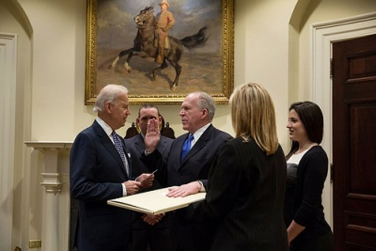 Vice President Joe Biden swears in CIA Director John Brennan in the Roosevelt Room of the White House, March 8, 2013. (Official White House Photo by David Lienemann)