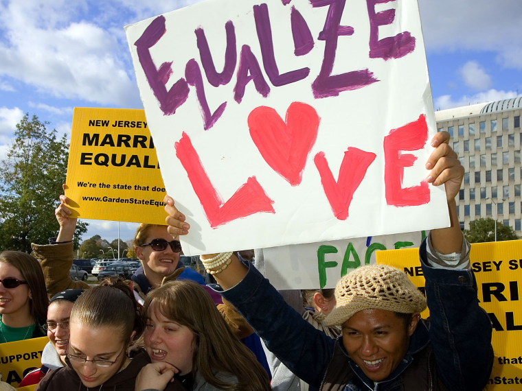 File Photo: Supporters await the New Jersey Supreme court decision on same-sex marriage in front of the Supreme court building October 25, 2006 in Trenton, New Jersey. New Jersey's highest court guaranteed gay couples the same rights as married...
