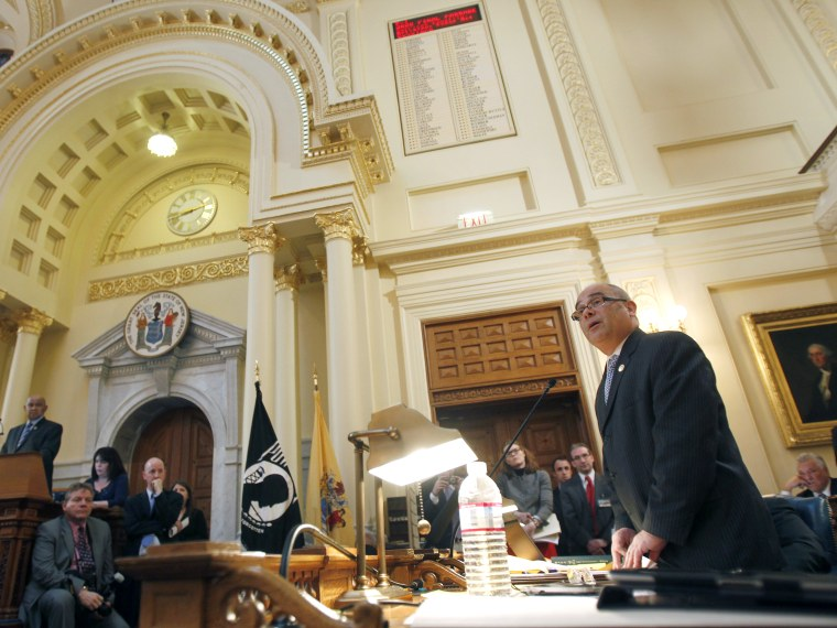 File Photo: Assemblyman Reed Gusciora D-Trenton, speaks about the bill he sponsored legalizing same-sex marriages, at the State House in Trenton, N.J., Thursday, Feb. 16, 2012. The New Jersey Assembly has passed a bill legalizing same-sex marriages,...