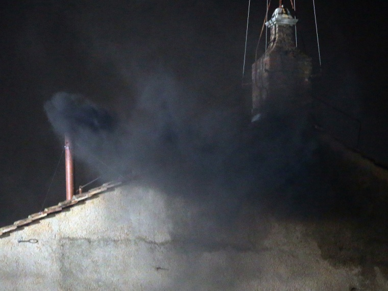 Black smoke billows out from a chimney on the roof of the Sistine Chapel indicating that the College of Cardinals have failed to elect a new Pope on March 12, 2013 in Vatican City, Vatican. Pope Benedict XVI's successor is being chosen by the College...