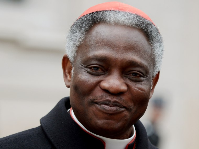 Ghanaian cardinal Peter Kodwo Appiah Turkson arrives to take part in an afternoon meeting of pre-conclave on March 8, 2013 at the Vatican. The day before, the next pope's ideal profile began to take shape as cardinals held a second day of pre-conclave...