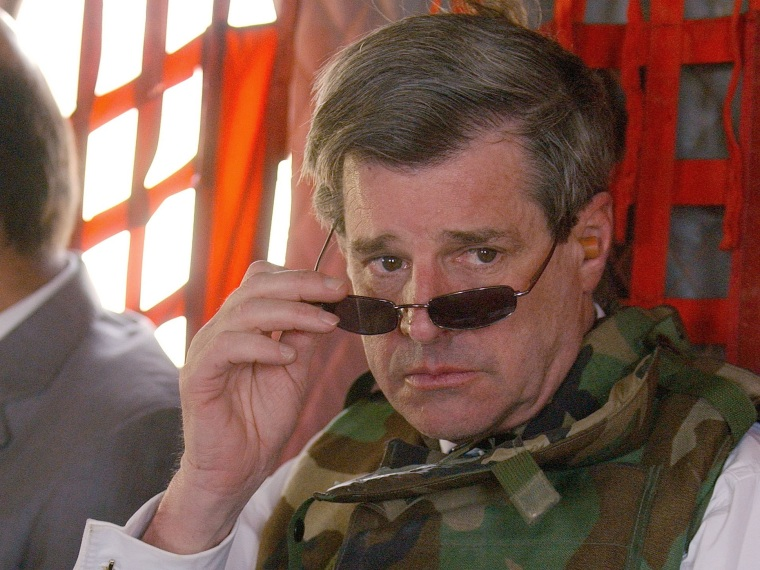 File Photo: Former U.S. civilian administrator in Iraq L. Paul Bremer (R) leaves the heavily-fortified Green Zone June 28, 2004 in Baghdad after signing the Iraqi Sovereignty document which gave full governmental authority to the Iraqi interim...