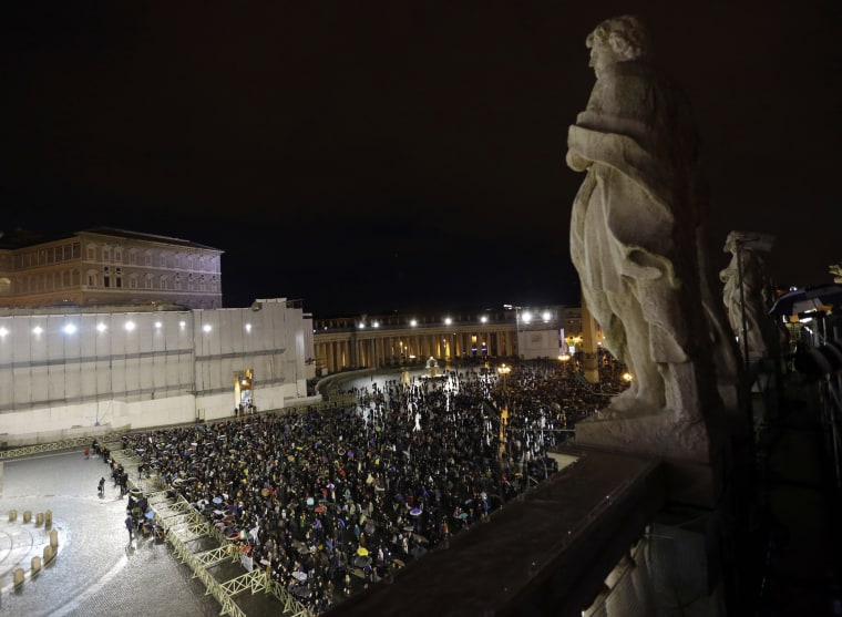 People gather in St. Peter's Square at the Vatican, Tuesday, March 12, 2013. Cardinals from around the globe locked themselves inside the Sistine Chapel on Tuesday to choose a new leader for the world's 1.2 billion Catholics and their troubled church. ...