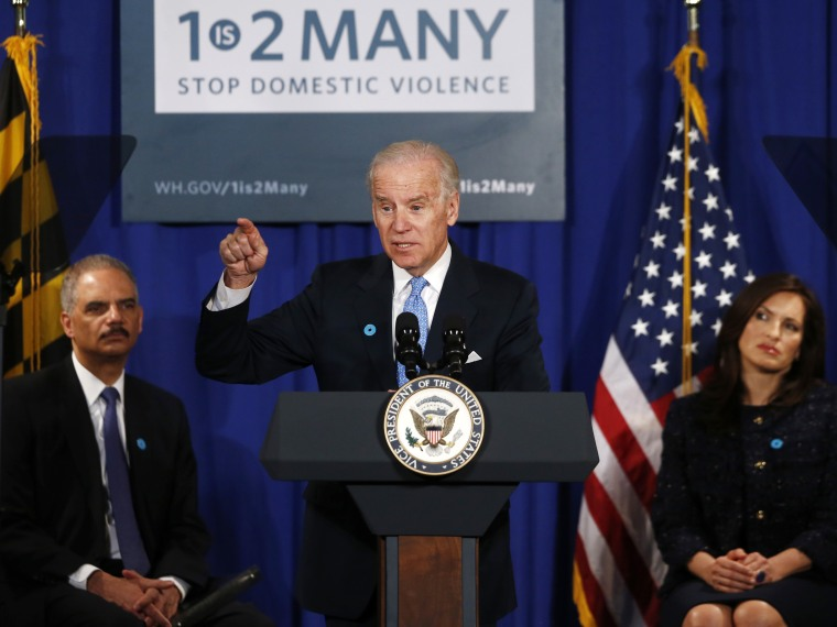Vice President Joe Biden, flanked by Attorney General Eric Holder, left, and actress Mariska Hargitay, gestures as he speaks about reducing domestic violence, Wednesday, March 13, 2013, at the Montgomery County Executive Office Building in Rockville,...