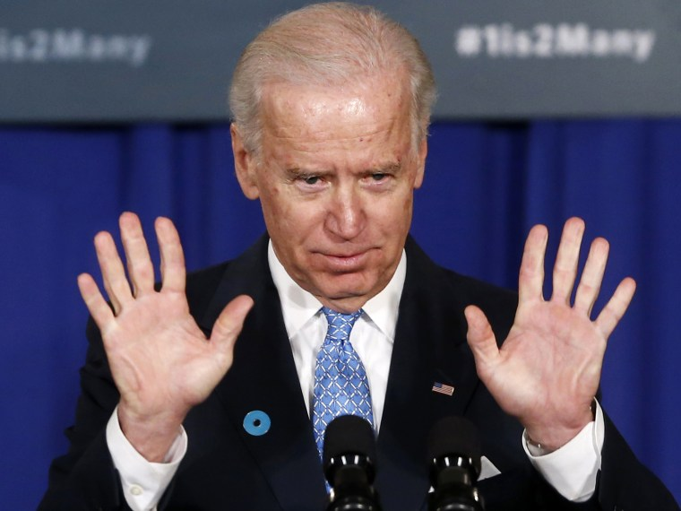 Vice President Joe Biden gestures  as he speaks about reducing domestic violence, Wednesday, March 13, 2013, at the Montgomery County Executive Office Building in Rockville, Md. (Photo by Charles Dharapak/AP Photo)