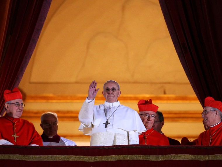 Newly elected Pope Francis I appears on the central balcony of St Peter's Basilica on March 13, 2013 in Vatican City, Vatican. Argentinian Cardinal Jorge Mario Bergoglio was elected as the 266th Pontiff and will lead the world's 1.2 billion Catholics....