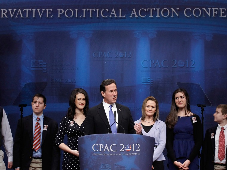 File Photo: Republican presidential candidate and former U.S. Senator Rick Santorum (4L) is joined on stage by his family as he delivers remarks to the Conservative Political Action Conference (CPAC) at the Marriott Wardman Park February 10, 2012 in...